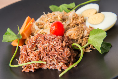 Spicy Tuna salad with brown healthy rice and boiled egg clean food