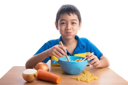 yummy: Little boy eating macaroni pasta healthy food