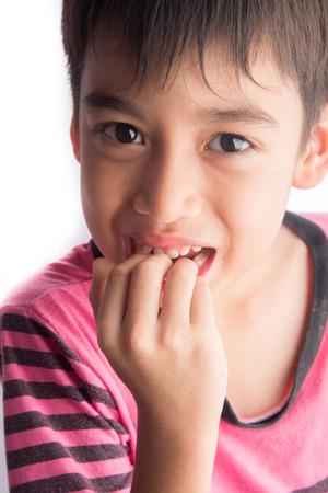 Little boy bite his nail finger