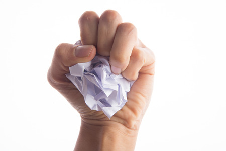 Hand's holding crumpled paper