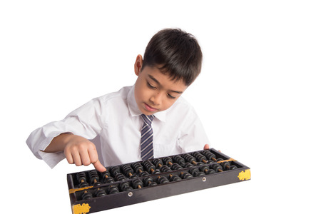 Little boy using abacus to study mathematic education class Stock Photo
