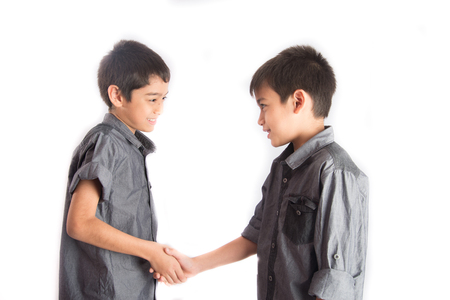 Little sibling boy checking hands together after fight
