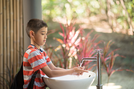 Little boy washing his hands  Archivio Fotografico