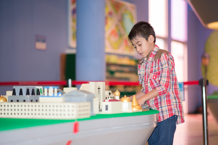 Little boy create build town and city by block many of buildings indoor activity Stock Photo