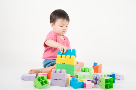 Asain baby Toddler 2 years old playing colorful blocks