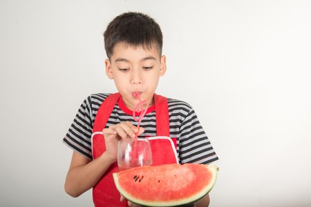 Little boys blend water melone juice by using blender at home
