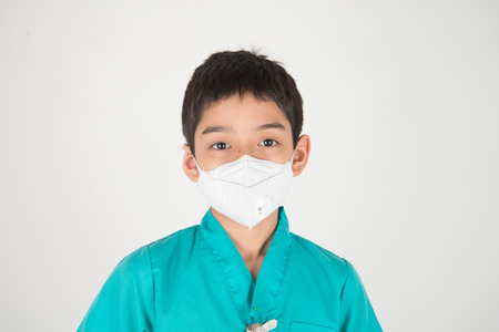 Bad polution air quality dangerous levels for kid get sick, boy wear mask protect from dust PM 2.5
