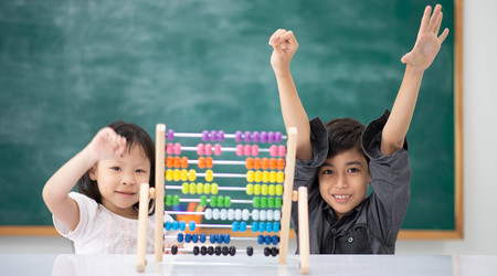Students boy and girl leaning math in the class room Montessori Stock Photo