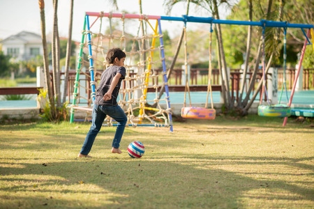 Little boy playing in the playground outdoor Imagens