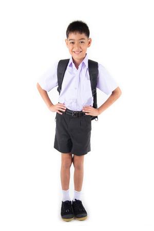 Little Asain boy in student uniform on white background