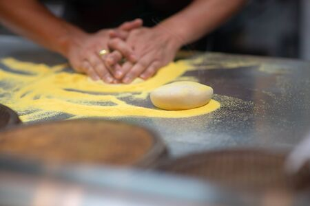 Worker making pizza in the restaurant