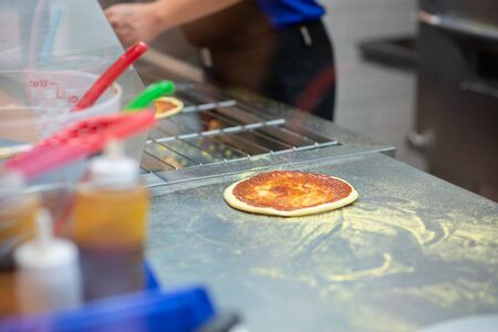 Worker making pizza in the restuarant
