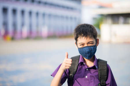 Asian mix rate walking at school wearing mask protect from virus new normal