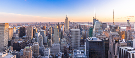 Panoramic photo of New York City Skyline in Manhattan downtown with skyscrapers at sunset USA