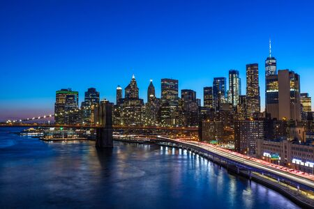 Brooklyn Bridge in Manhattan downtown with Cityscape at night New York USA