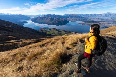 Young asian traveler backpack hiking on Roys peak track, Wanaka, South Island, New Zealand