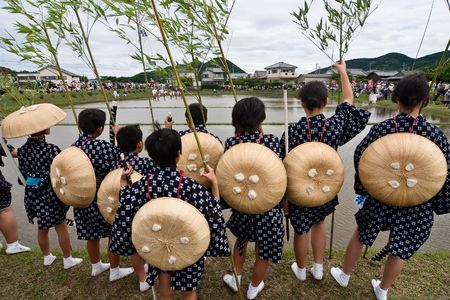 Participants watching an agricultural festival in a rice field in southern Japan. Stock Photo