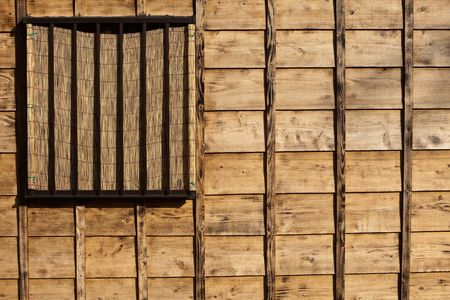 Old look textured wood siding on a building looking somewhat like the U.S.A flag