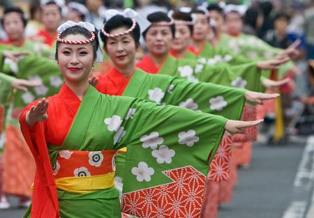 Kagoshima City, October 26th, 2008. Women in kimono dancing in a symmetrical line during the Taniyama Furusato Matsuri.