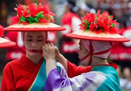 Kagoshima City, Japan, November 3rd, 2008. Women in kimono preparing to dance during the Ohara Matsuri festival.