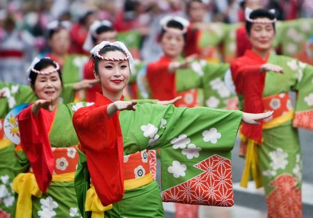 Kagoshima City, Japan, November 3rd, 2008. Women in kimono dancing in a symmetrical line during the Ohara Matsuri dance festival. The festival has over 10,000 dancers participating in any given year.