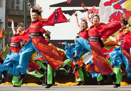 Kagoshima City, Japan, April 26, 2008. Dancers in blue and red costume performing onstage in the Daihanya Festival held in Kagoshima City, Japan. Editorial
