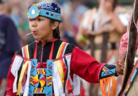 Ohsweken, Ontario, Canada, July 27, 2008. A young female Powwow Dancer in the casual entrance dance during the Grand River Champion of Champions Powwow. Editorial