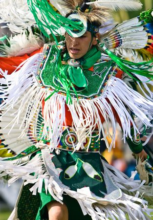 Ohsweken, Ontario, Canada, July 27, 2008. A fancy dancer in green and white performs during the Grand River Champion of Champions Powwow.