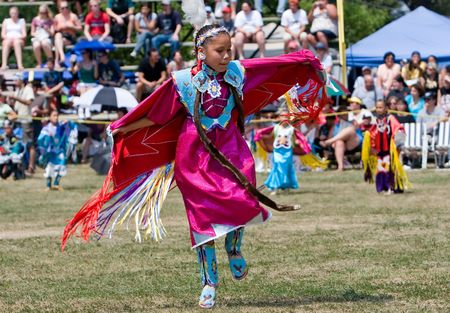 Ohsweken, Ontario, Canada, July 27, 2008. A young Shawl Dancer performs during the Grand River Champion of Champions Powwow. The dance symbolizes the life of a butterfly. Editorial