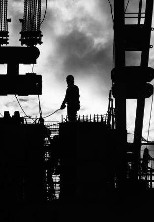 steel cable: Construction iron workers outdoors in silhouette