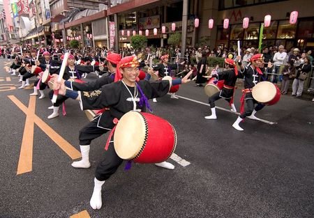 Kagoshima City, Japan, November 3, 2005. Drummers in Okinawan costume drumming in symmetry during the Ohara Matsuri dance festival. Editorial