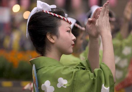 Kagoshima City, Japan, November 3, 2005. A woman in yukata kimono dancing in symmetry during the Ohara Matsuri dance festival. Stock Photo - 6888909