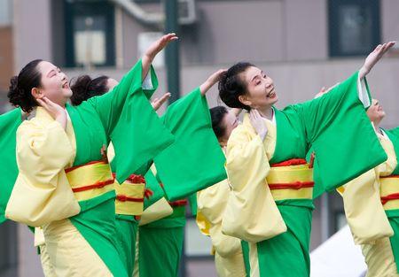 Kagoshima City, Japan, April 26, 2008. Dancers in green and yellow yukata kimono performing in the Daihanya Festival held in Kagoshima City, Japan.