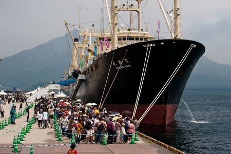 whaling: Kagoshima City, Japan, April 27, 2008, People waiting in line to board the whaling factory ship Nisshin Maru, berthed at a whaling festival in Kagoshima, Japan.