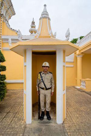 Phnom Penh, Cambodia, January 2, 2008,  A palace guard at his post outside the palace in Phnom Penh.