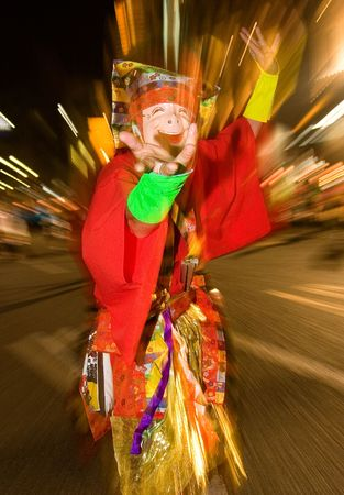 Kagoshima, Japan, November 2, 2006. Masked Japanese Festival Dancer in colorful costume Editorial