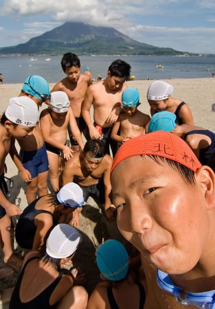 Kagoshima City, Japan, July 15, 2007. Elementary school students play a agame with their teacher at the beach.