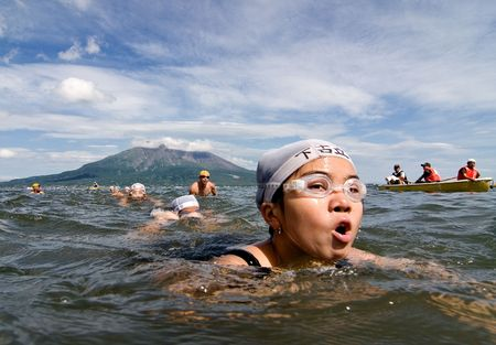 Kagoshima City, Japan, July 15, 2007. Elementary school students swimming together in practice for a 4km swim from the volcano Sakurajima to the beach.