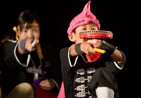 Kagoshima City, Japan, September 29, 2007. An Okinawan drum group performs onstage at night.