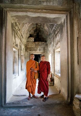 Angkor Wat, Cambodia, December 27, 2007. Two young Buddhist priests in a hallway inside the Angkor Wat comple Editorial