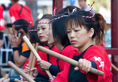 Kagoshima City, Japan, November 3, 2006, Female taiko drummers prepare to perform during the Ohara Matsuri dance festival.. Editorial