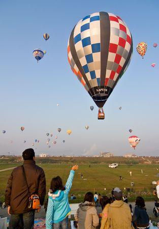 saga: Saga, Japan, November 5, 2006, Spectators watch hot air balloons rise into the early morning air at the yearly Saga Balloon Festival,