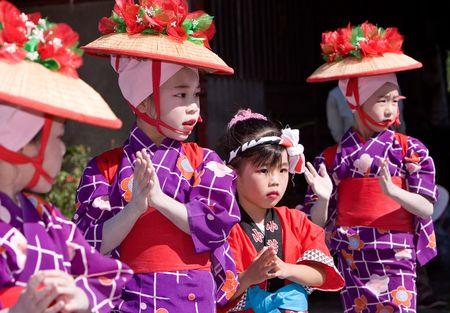 Kagoshima City, Japan, October 28, 2007. Young girls  in yukata kimono dancing during the Taniyama Furusato  Matsuri dance festival. Stock Photo - 6935402