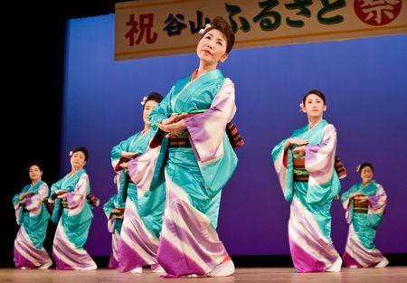 Kagoshima City, Japan, October 27, 2007. Japanese dancers in kimono perform onstage in the night portion of the Taniyama Furusato Matsuri festival held in Kagoshima City, Japan. Editorial