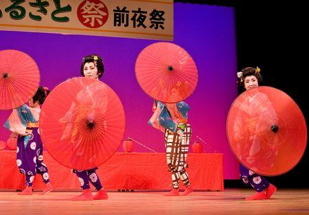 Kagoshima City, Japan, October 27, 2007. Japanese dancers in traditional costume  perform with umbrellas onstage in the Taniyama Furusato Matsuri festival held in Kagoshima City, Japan.