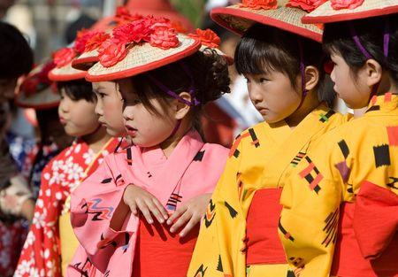 Kagoshima City, Japan, October 28, 2007. Young girls  in yukata kimono and straw hats preparing  to dance during the Taniyama Furusato Matsuri dance festival. Editorial