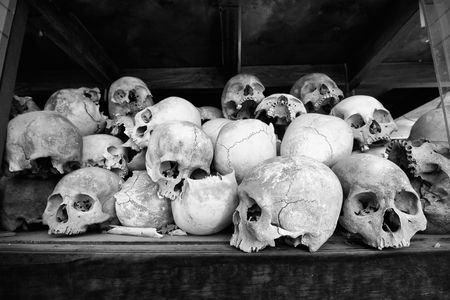 the stupa: Skulls of torture victims rest in a stupa at the Killing Fields outside of Phnom Penh, Cambodia.  Stock Photo