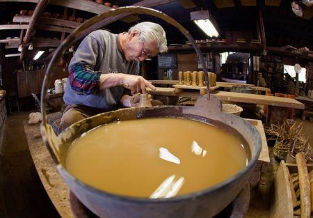 Kirishima City, Kagoshima, Japan, March 18,  - March 18, 2009. A potter makes handles for traditional Satsuma pottery. Satsuma pottery dates to 16th century Kagoshima.