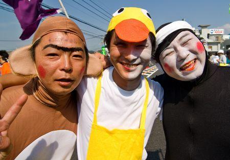 Kagoshima City, Japan, October 22, 2006. Men wearing face makeup dances during the Taniyama Furusato Matsuri dance festival