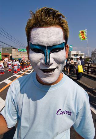 Kagoshima City, Japan, October 22, 2006. Man wearing face makeup dances during the Taniyama Furusato Matsuri dance festival
